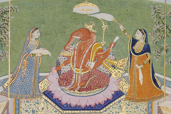 attendants fanning ganesha